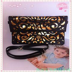 Korean version of the new energy-saving hollow leopard envelope bag hand bag shoulder bag cross dating makeup bag Abnormal sex
