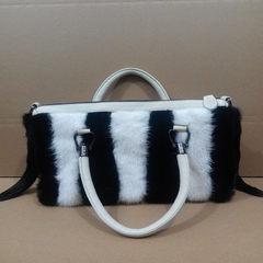 The new leather bags bag leather bag leather mink mink wool Plush bag fox portable shoulder bag. White and black