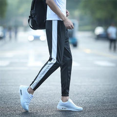 Trend of Korean youth leisure pants nine male all-match new pants students Guardian pants feet Haren pants S English letters on the side
