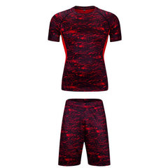 The new running tights suit has two sets of men`s stretch five-minute trousers, basketball quick-dry red s.