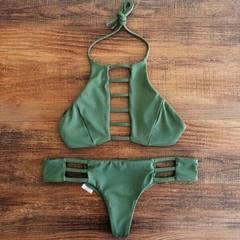 The new bikini bikini-type green T swimsuit has the sexy leaking back of the bikini to show the thin green s.