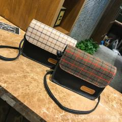 The new style of women`s autumn and winter mini bag in Korea is featured with the style of one-shoul brown