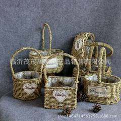 Cane makes up handwork to decorate the flower basket that inserts a flower basket to occupy the home C