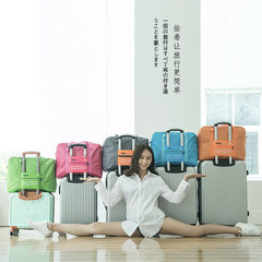 New luggage case bag portable waterproof folding women`s travel bag with large capacity to reduce th Light blue