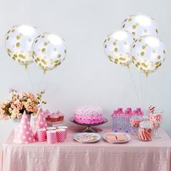 A 12-inch transparent, gold, round, sequinned pape A 12-inch gold sequinned transparent balloon