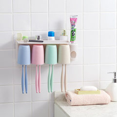 Suction wall type toothbrush holder washing and ga Toothpaste squeezer